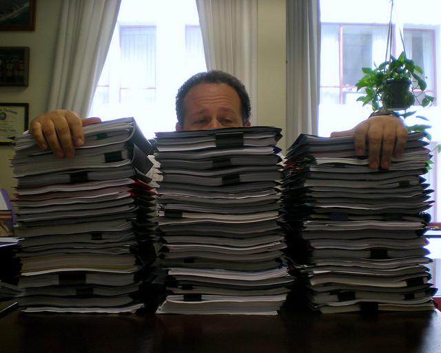 piled up at desk